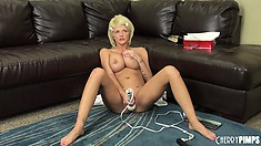 Busty blonde Joslyn toys her pussy and vibrates her clit on the couch, then gets on the floor